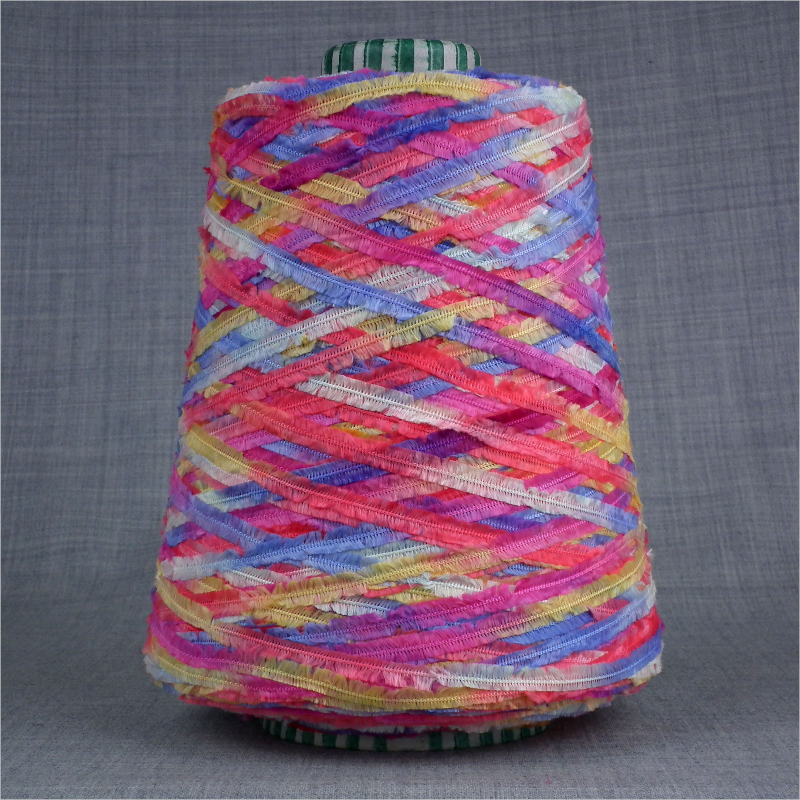 Space dyed feather yarn on cone pink blue lilac yellow