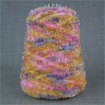 Chunky space dyed feather yarn on cone pink blue yellow