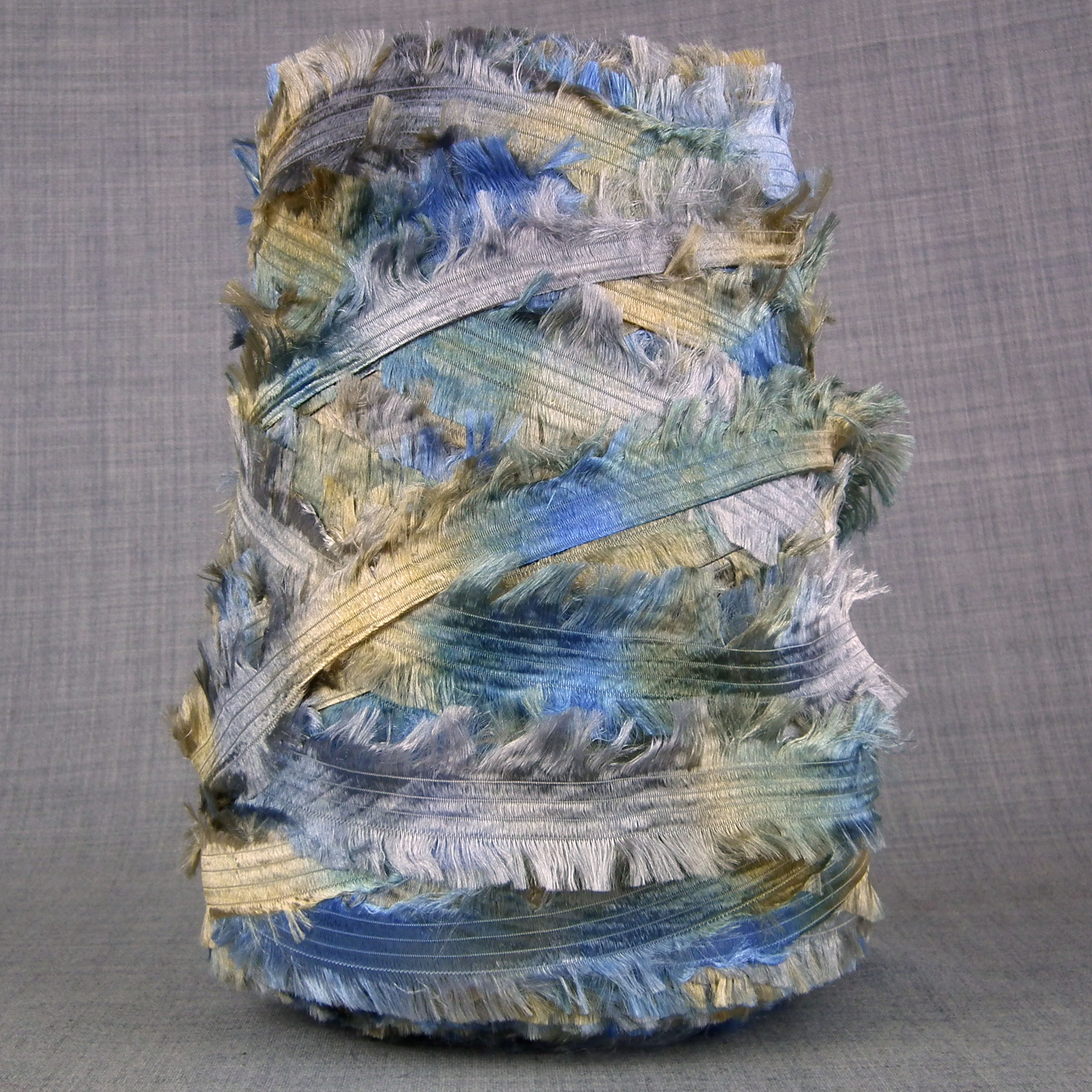 chunky space dyed feather yarn gold silver blue green machine knitting uk yarn on cone